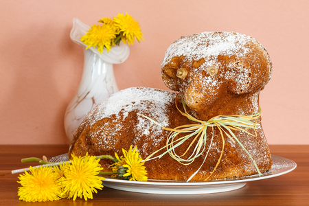 Czech Easter - baked lamb with powdered sugar and dandelions on  wood desk