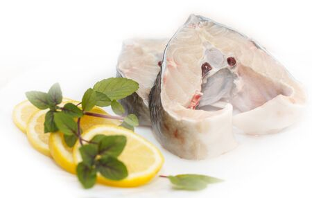two slices of the Sturgeon (disambiguation) with lemon on white background