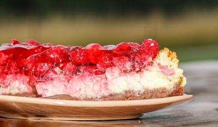 cut of a raspberry cake on plate