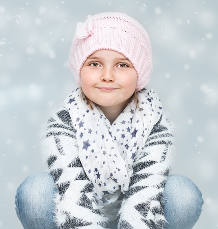 cute young girl in Christmas time on winter background - Christmas greeting card