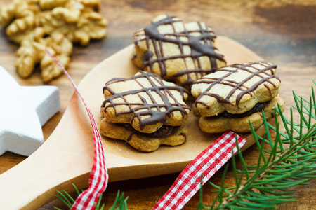 close up of Christmas sweets on a wooden spoon Stock Photo