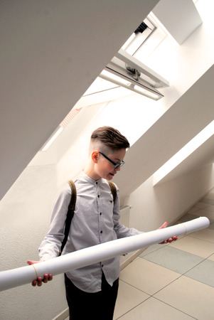 The school student thinking of the future geometry lesson. Stock Photo