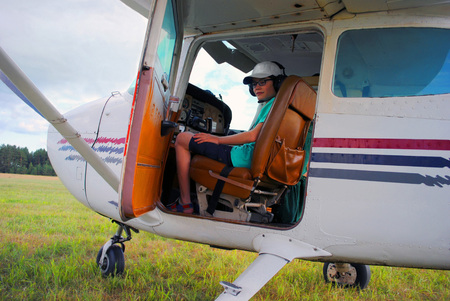The young man learns to drive the plane
