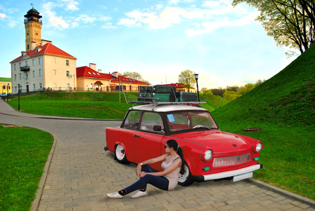 The young girl travels by vintage car all over the world