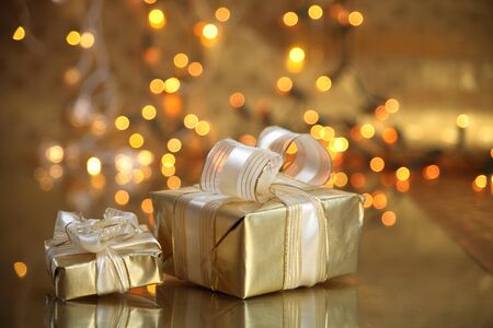 suprise: Gift boxes on golden background