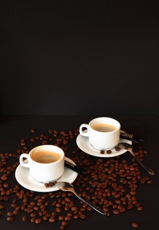 Coffee in white cups with roasted beans Stock Photo - 9342455