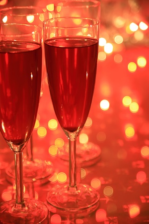 Champagne in glasses and twinkle lights photo