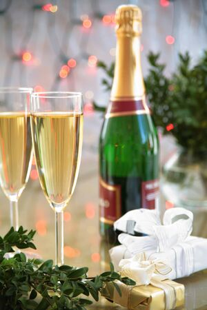 Champagne in glasses,green twig and twinkle lights photo