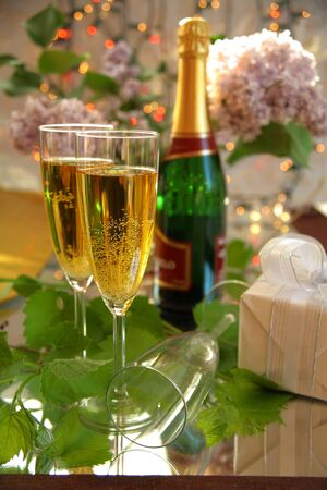 Champagne in glasses,green grape-vine and lights Stock Photo - 9637664