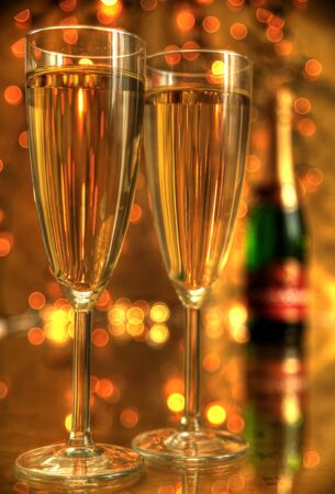 Closeup of champagne in glasses photo