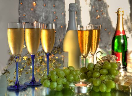 Champagne in glasses and grapes.