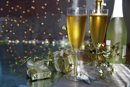 Champagne in glasses and gifts photo