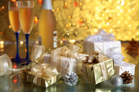 wedding gift: Gift boxes and champagne in glasses. Stock Photo