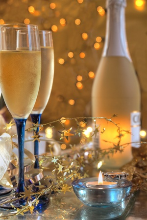 Champagne on gold background with lights. photo