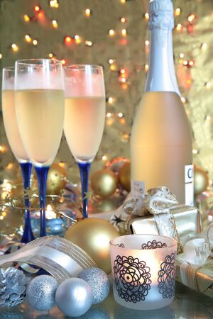 Champagne in glasses and bauble.