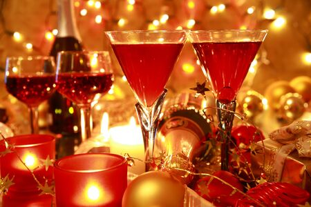 Red wine,baubles,candle lights on background with burred lights.