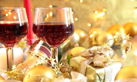 Red wine in glasses and baubles,candle lights,gifts. photo