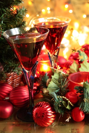 Red wine in glasses and bauble,candle lights. Stock Photo - 11075095