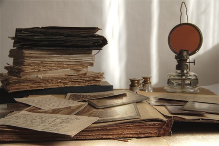 ancestry: Closeup of old photos,letters and books.