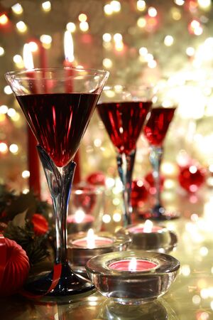 Red wine in glasses and bauble,candle lights. photo