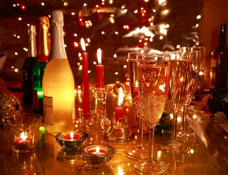 cheers: Closeup of champagne in glasses and bottles. Stock Photo