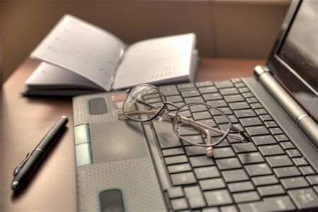 Netbook and glasses Stock Photo - 13078033