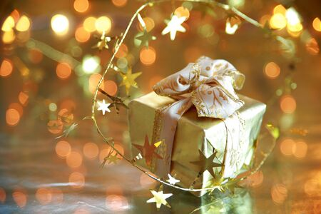Gift box on golden background  photo