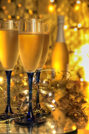Champagne in glasses on golden background. photo