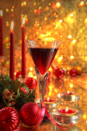 Red wine, baubles,candle and blurred lights. photo