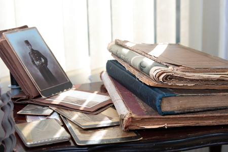 memento: Old photos, books and newspapers. Stock Photo