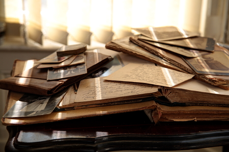 Old photos, books and newspapers. Stock Photo