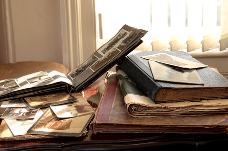 hereditary: Old photos, books and newspapers. Stock Photo