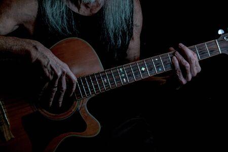 frets: Guitar player.