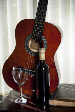 fret: Wine and guitar.