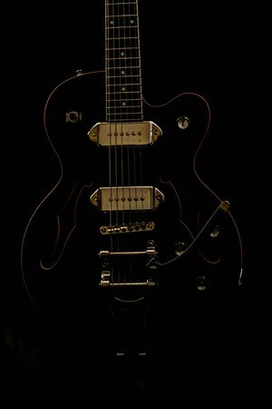 Guitar in darkness.