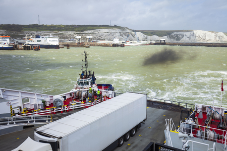 View of Dover port from the ferry.The tugboat helps the ferry in maneuvers.