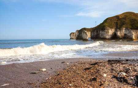 View of North Sea coast and cliffs in Flamborough during the tide. Yorkshire, Great Britain.
