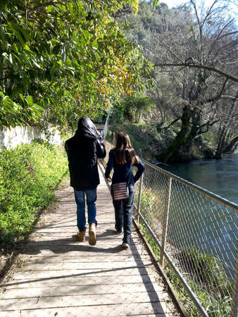 Promende a girl and boy near the river Stock Photo