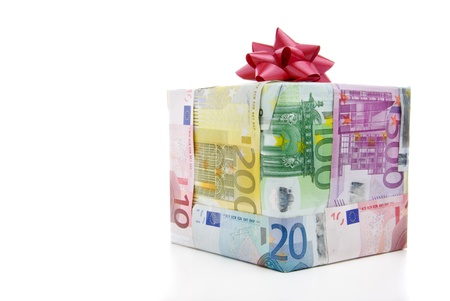 Different euro bills packed as a present isolated on a white background photo