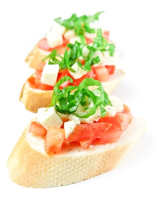 entree: Bruschetta with fresh diced tomatoes, mozzarella and fresh basil isolated on white