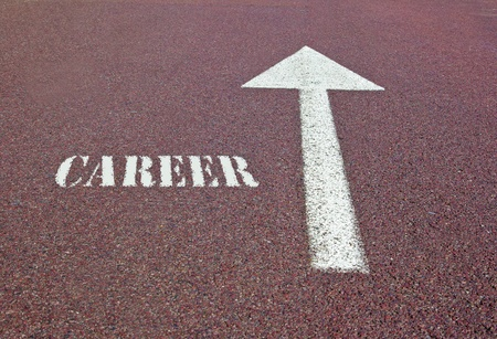 an arrow on the asphalt showing the direction for making a career photo