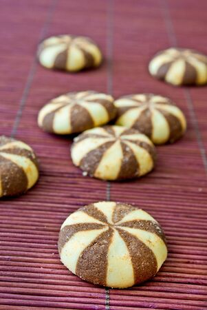 Golden brown cookies on a bamboo background photo