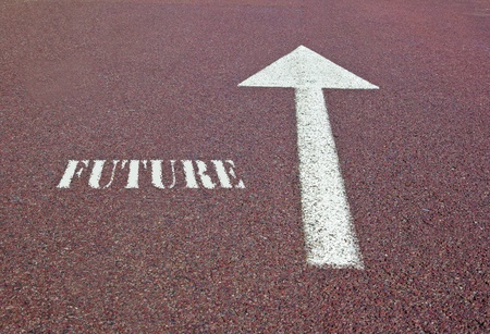 an arrow on the asphalt showing the future direction photo