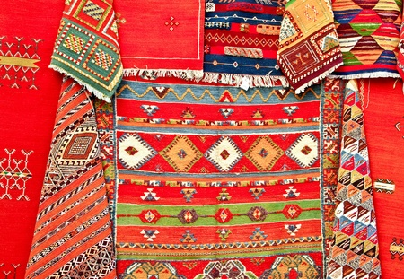 Colorful moroccan rugs on the market photo