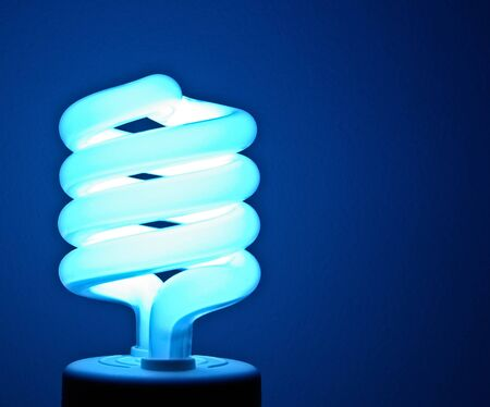 energy costs: A florescent bulb symbolizing the saving energy of and money