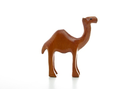 A wooden camels isolated on a white background Stock Photo - 10017334