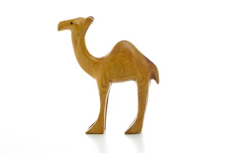 A wooden camels isolated on a white background Stock Photo - 10017338