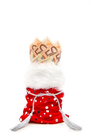 christmas profits: euro bills fanned in a red present-bag isolated on a white background Stock Photo