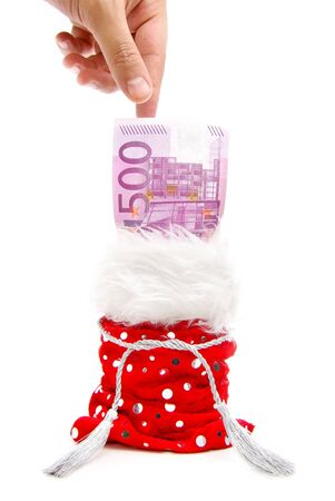 a hand aiming to take a bank note from a red present-bag isolated on a white background Stock Photo - 10017673