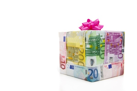euro banknote: Different euro bills packed as a present isolated on a white background Stock Photo